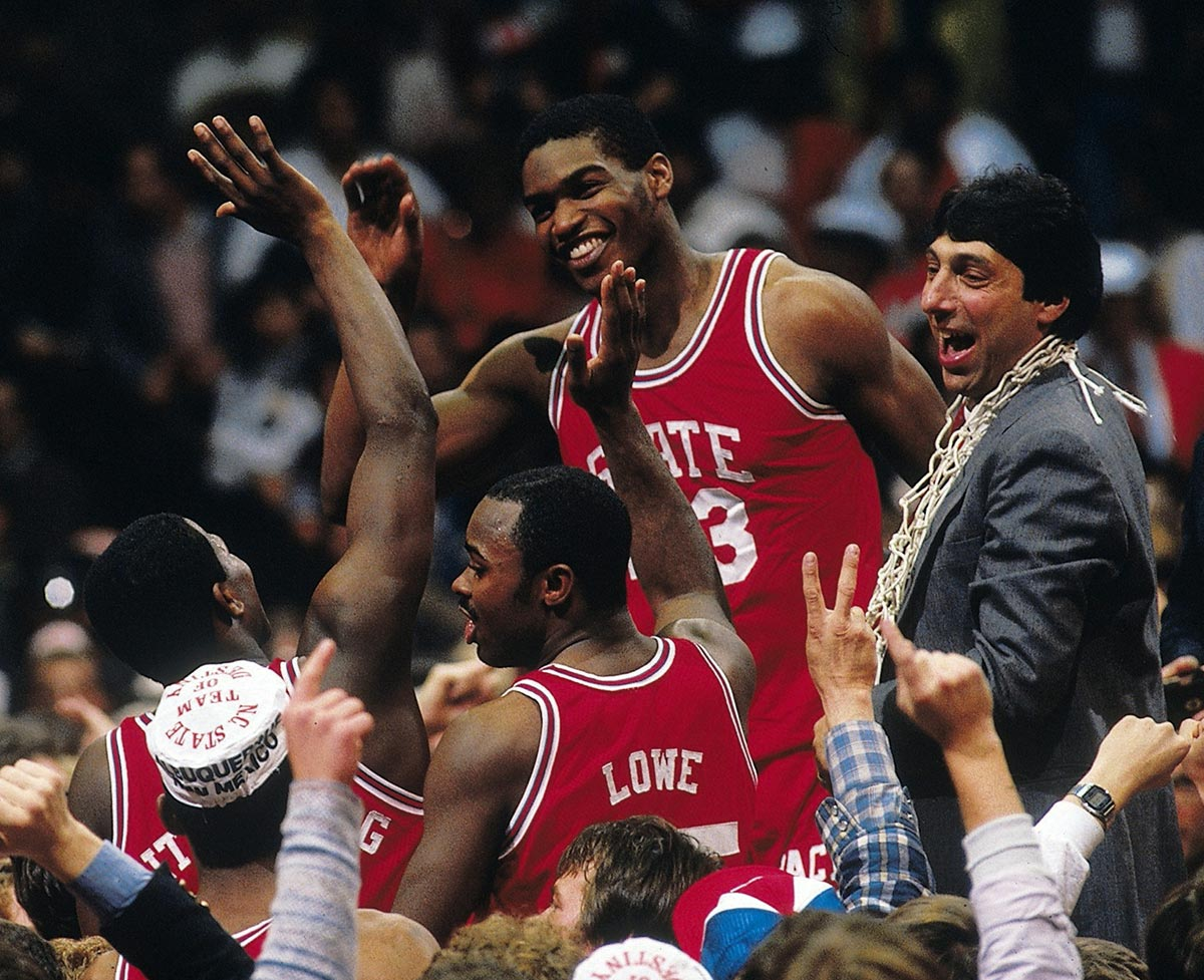 Albuquerque, April 4, 1983 | Lorenzo Charles and N.C. State coach Jim Valvano celebrate with others the Wolfpack's upset win over Houston in the NCAA Championship game.