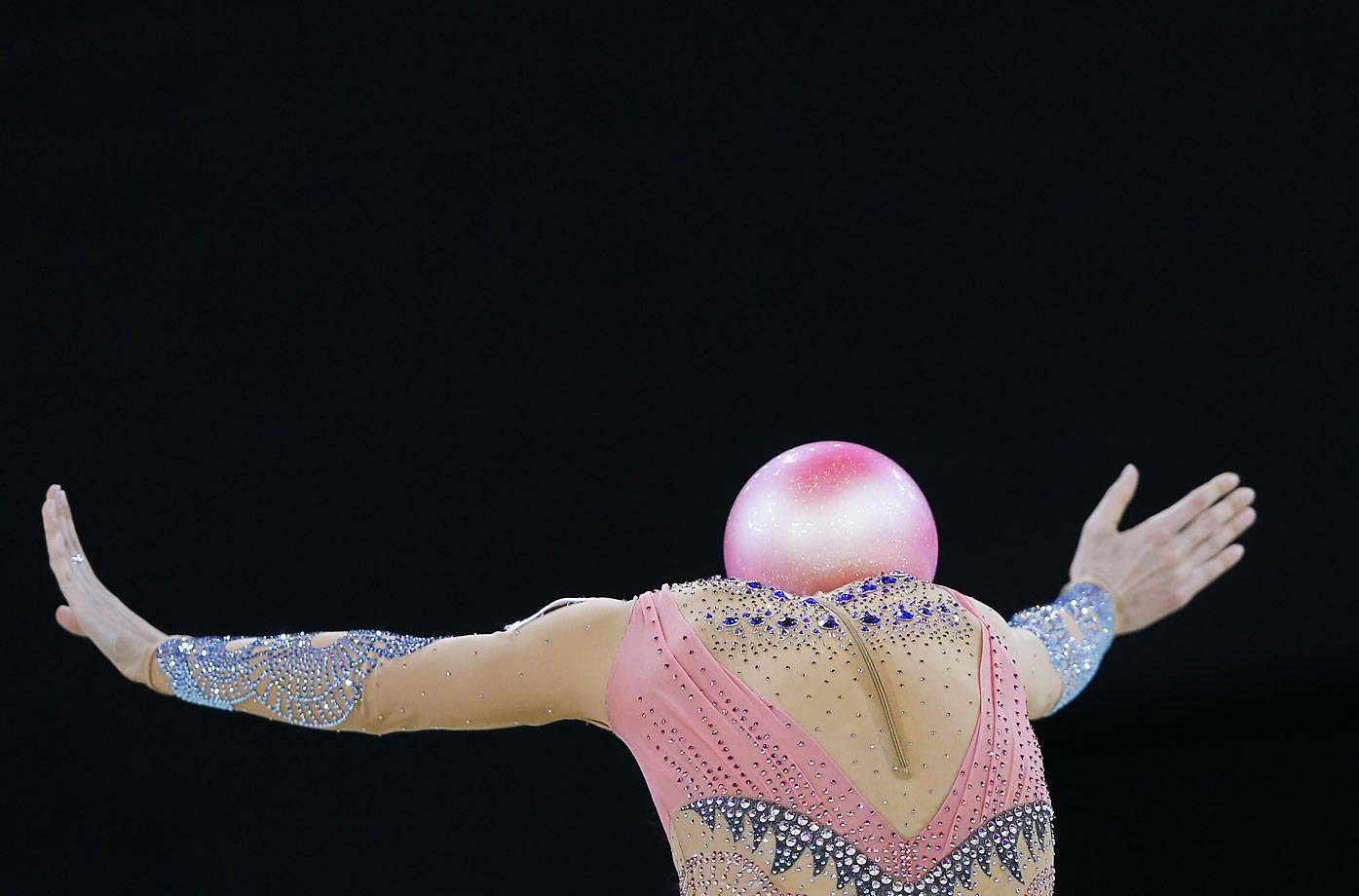 The graceful Jaelle Cohen of Australia performs her ball routine during the Rhythmic Individual All-Around competition at the Glasgow Commonwealth Games in Scotland.