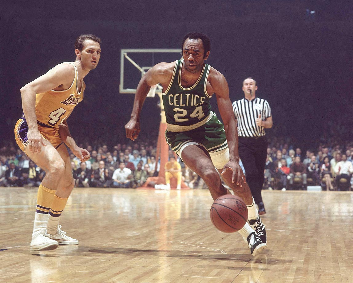 Sam Jones of the Celtics dribbles around Jerry West of the Lakers. Jones would hit the game-winner in Game 4 of the 1969 finals to even the series at two games. Boston would go on to take the title in seven.