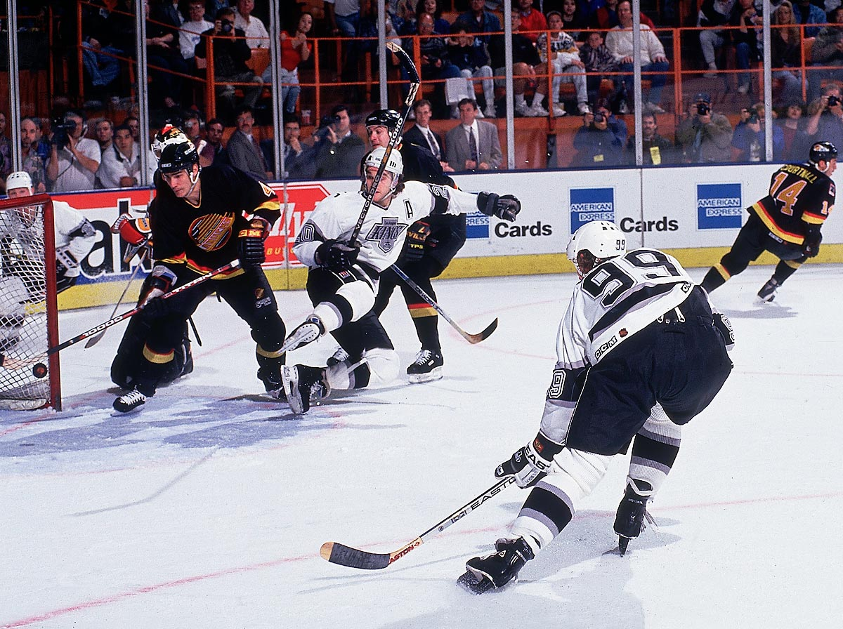 Kings vs. Canucks, March 23, 1994 | Kings center Wayne Gretzky scores his 802nd career goal, passing Gordie Howe as the NHL's all-time leading goal scorer. Gretzky finished his career with 894.