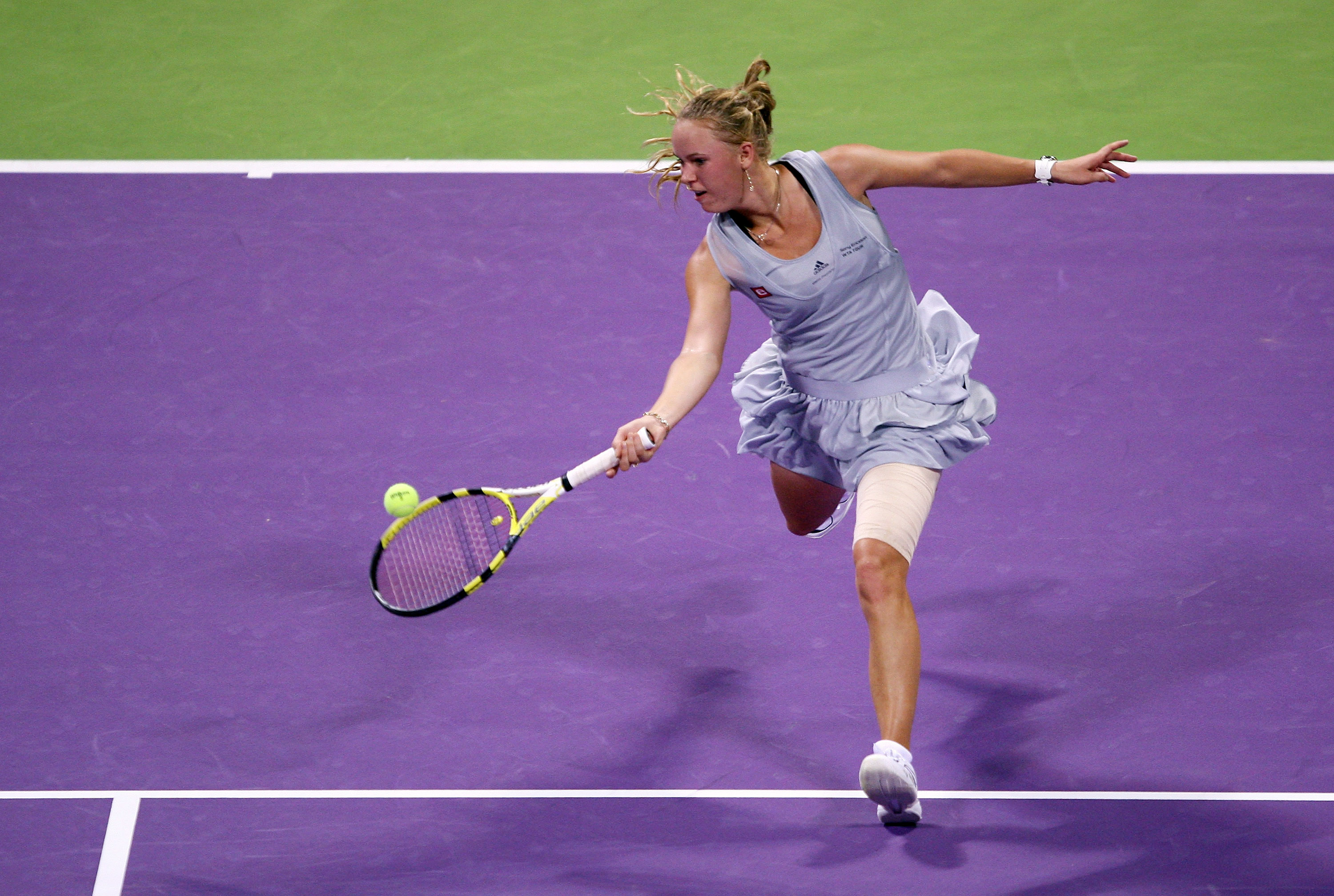 In the same dress but different colorway, Wozniacki qualifies for her first WTA Championships in Doha.