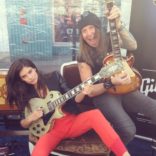 Learning how to play guitar with the awesome @bigrockshowinfo here In Nashville at #swimville with @si_swimsuit