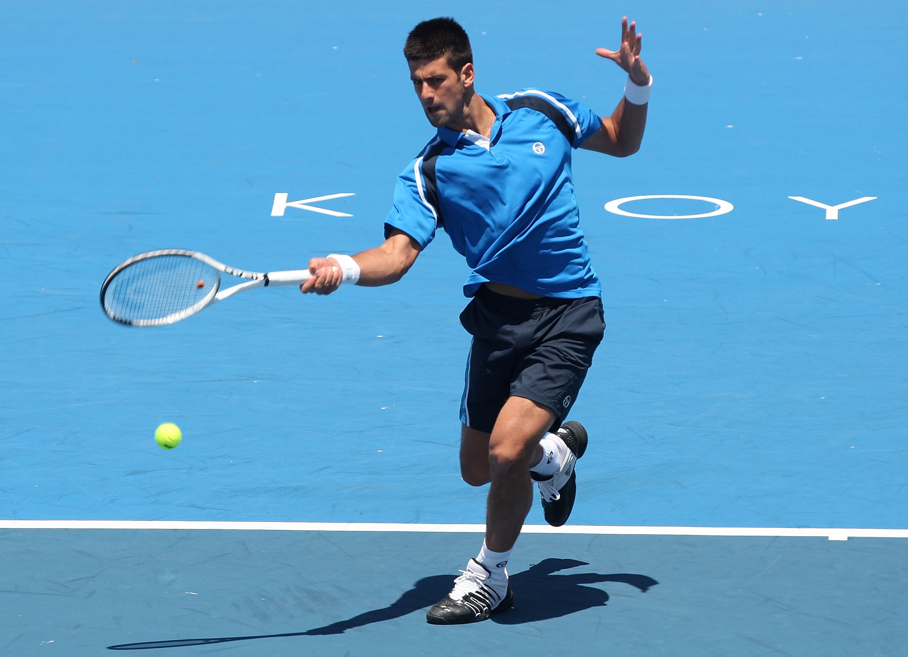 Nole matched the courts in Melbourne and added all-white wristbands.