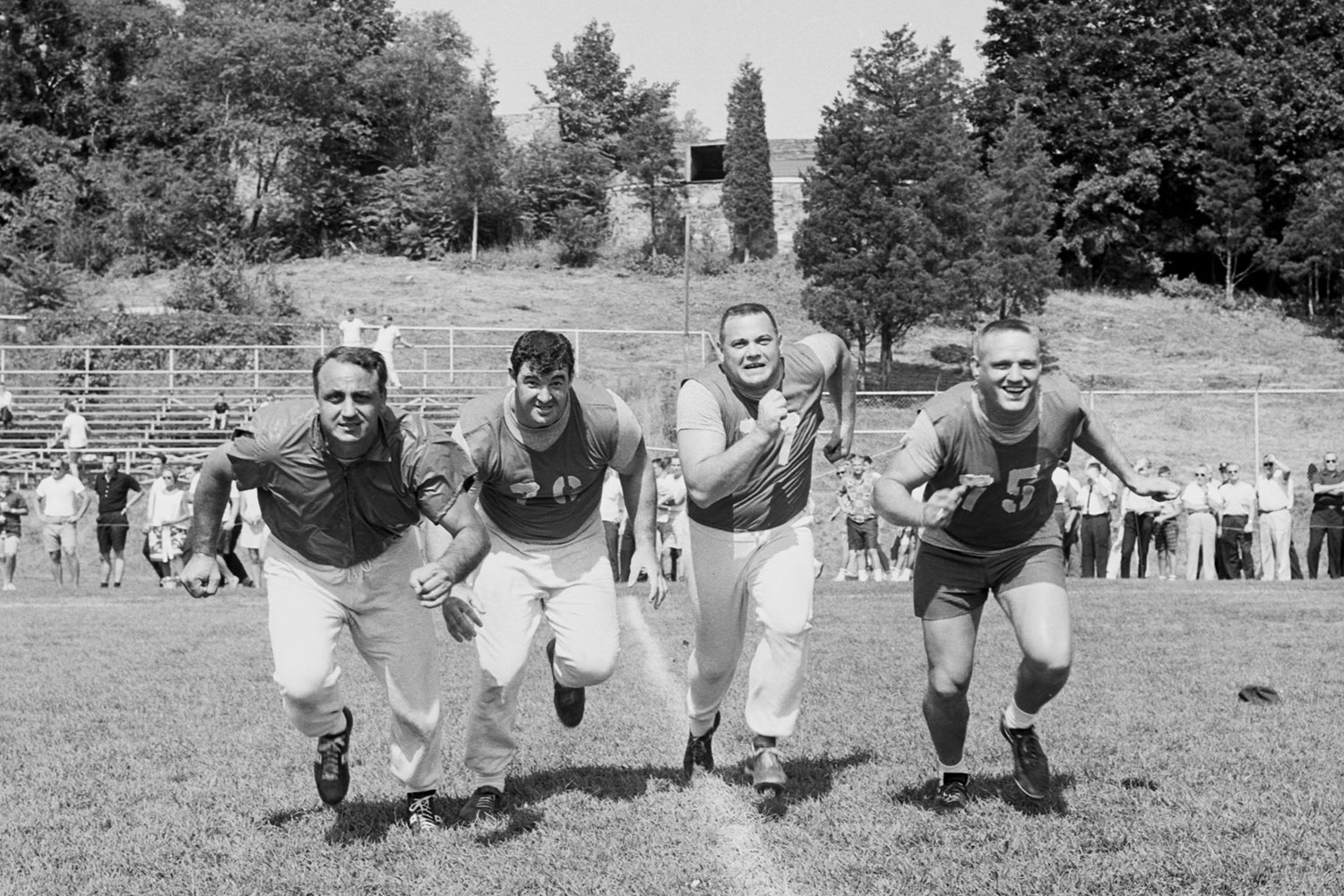 Andy Robustelli, John LoVetere, Dick Modzelewski and Jim Katcavage running during New York Giants training camp at Fairfield University in August 1963.
