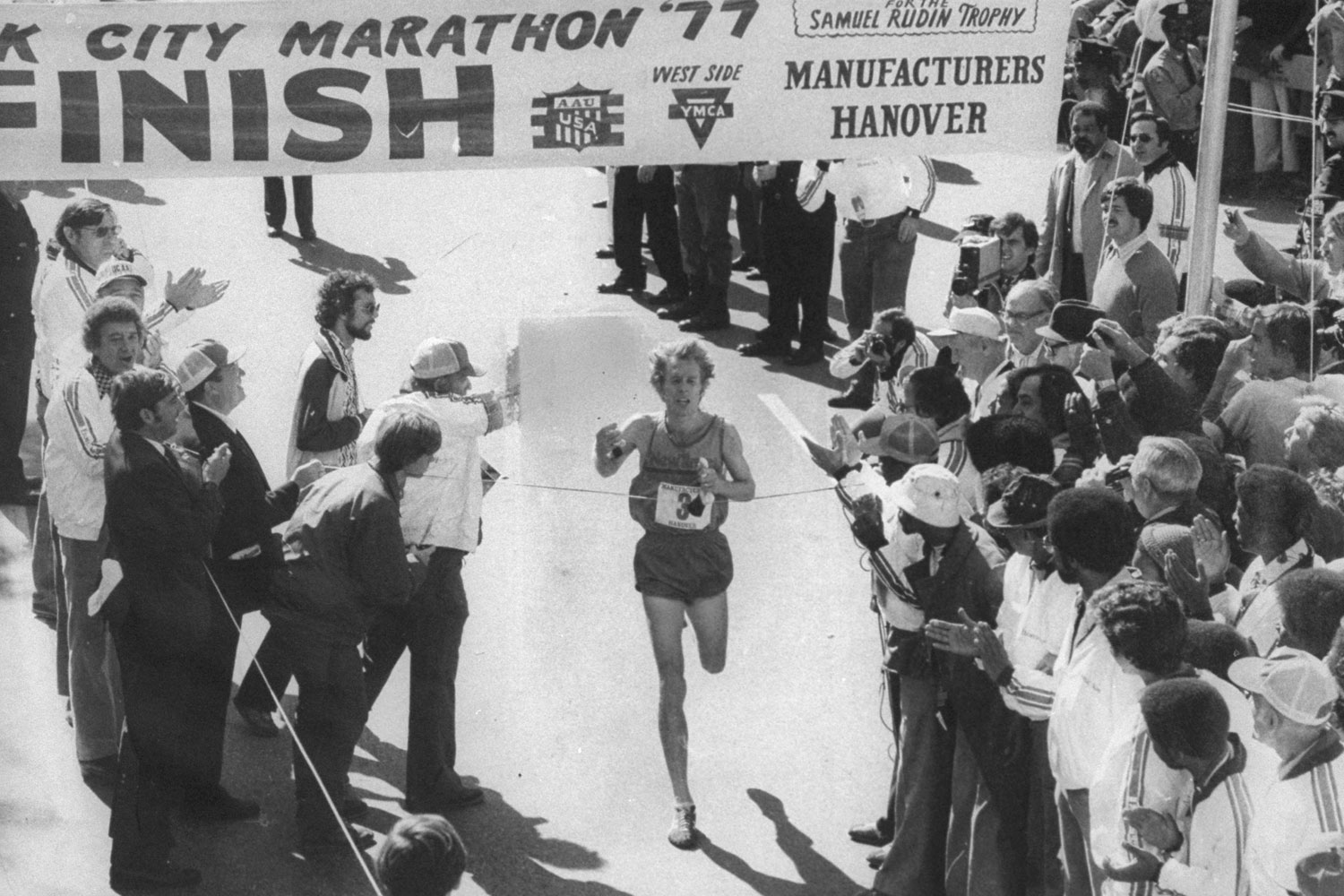 Marathon winner Bill Rodgers crosses the finish line in Central Park.