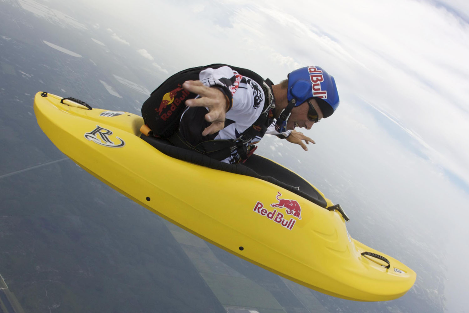 Miles Daisher Skyaking in freefall in Sebastian, Florida. Danger man Miles Daisher casts a bizarre image paddling across the sky - 13,000 feet up in a KAYAK.