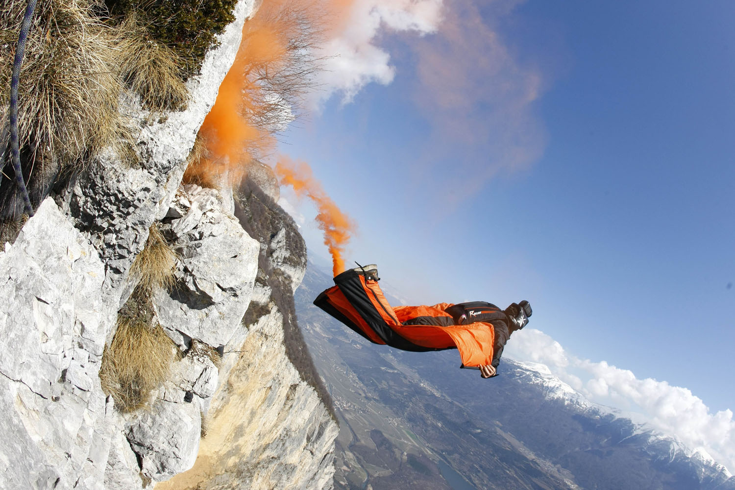 James Boole jumps from the top of Monte Trento peak in Trento, Italy.
