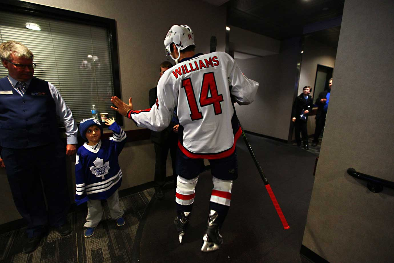 On his way out to the ice, the Capitals' veteran forward greets an enemy fan.