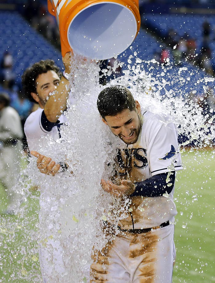 Kevin Kiermaier of the Tampa Bay Rays gets doused by David DeJesus after the Rays defeated the Nationals 6-1.