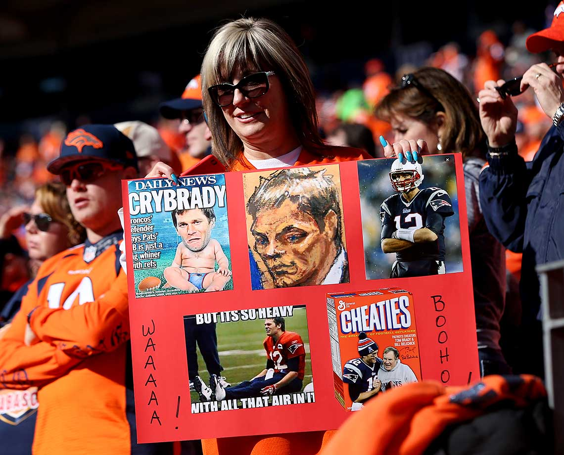 A Denver Broncos fan with a Brady-centric sign before the AFC Championship game.