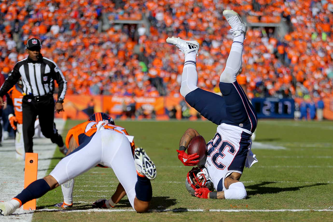 Brandon Bolden of the New England Patriots is tackled by T.J. Ward after a 20-yard run.