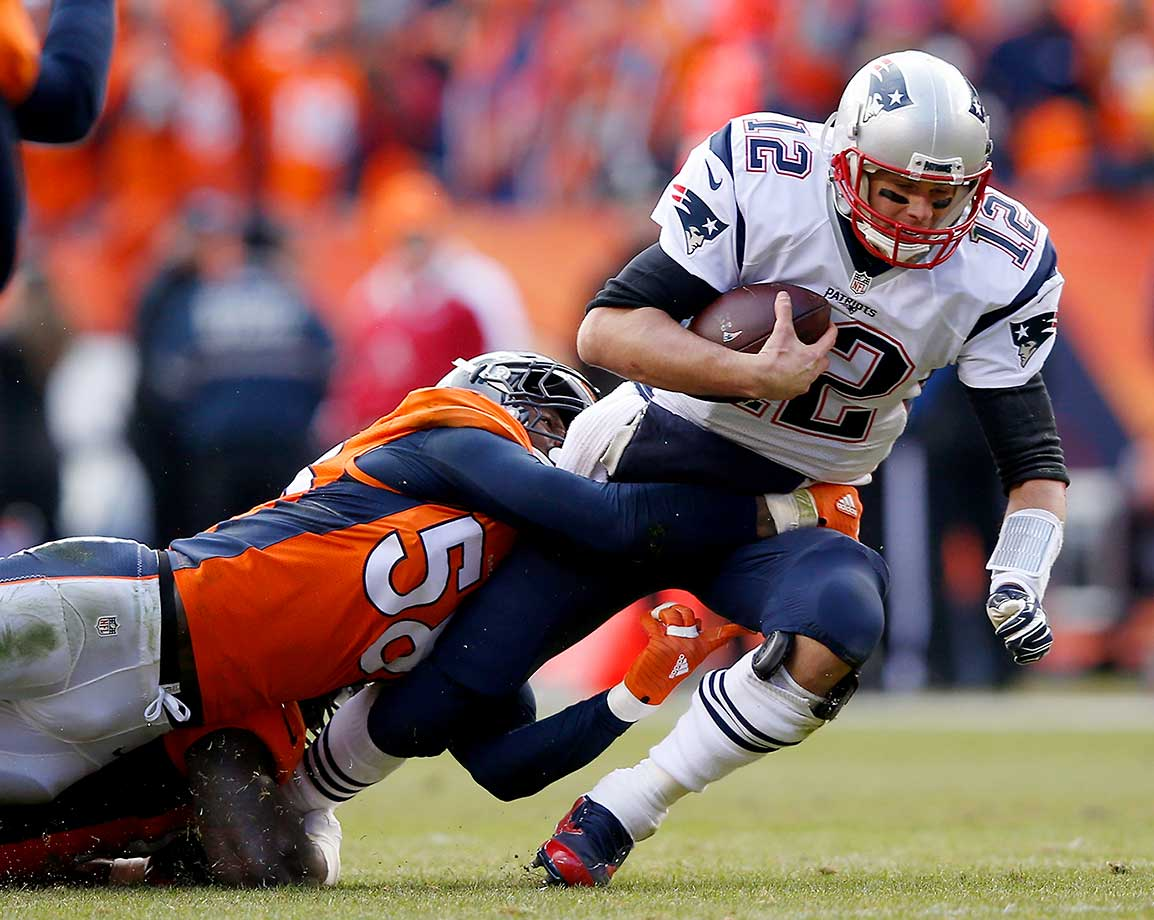 Tom Brady is sacked by  Von Miller in the second quarter.
