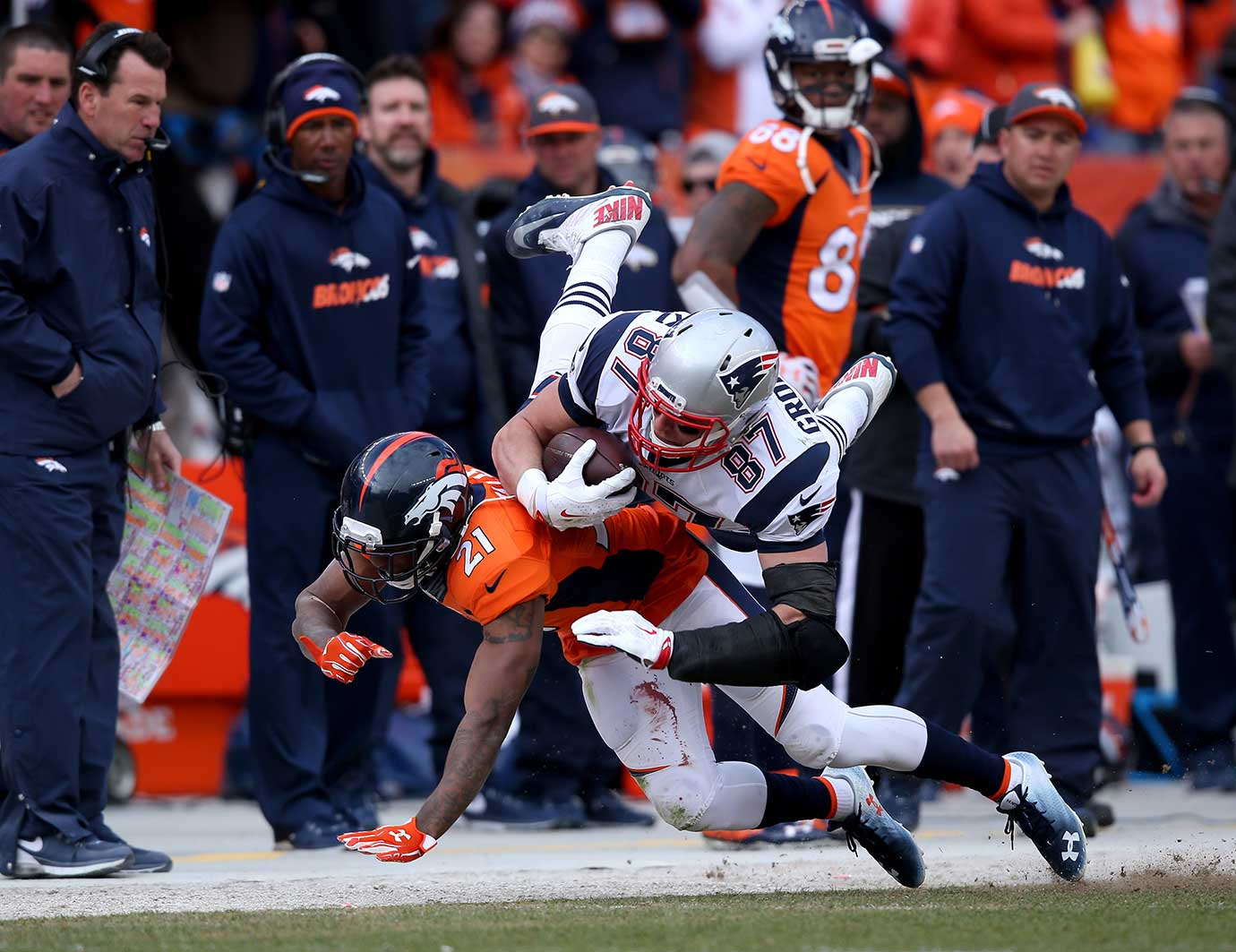 Aqib Talib tackles Rob Gronkowski after a first down in the third quarter.