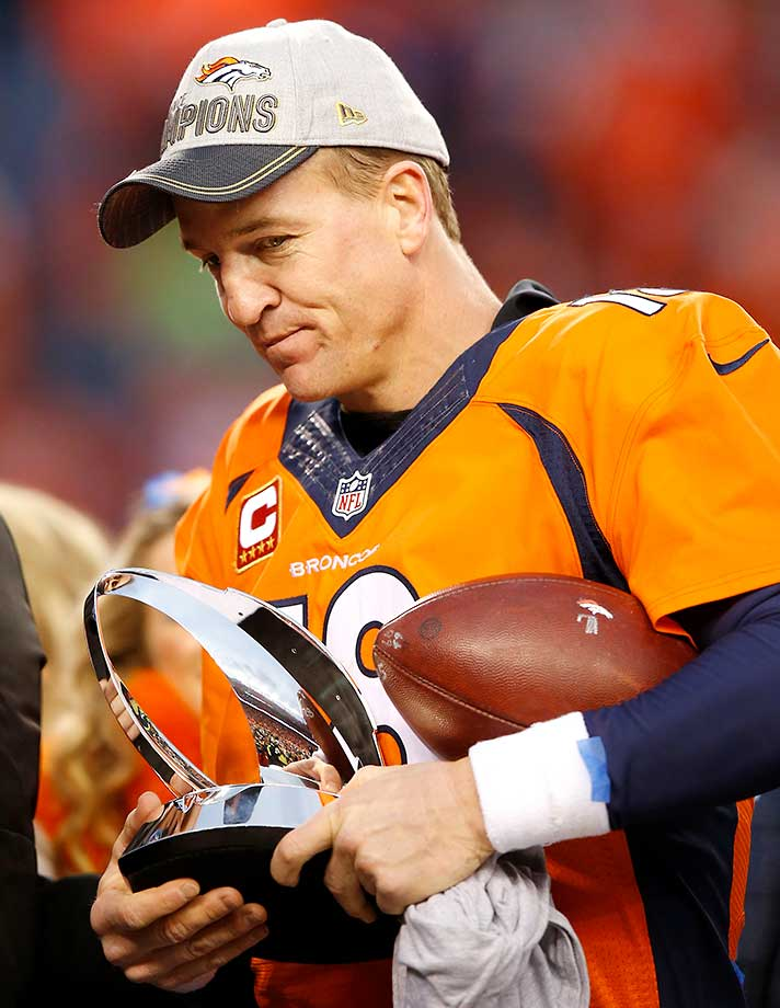 Peyton Manning holds the Lamar Hunt Trophy after defeating the New England Patriots in the AFC Championship game.