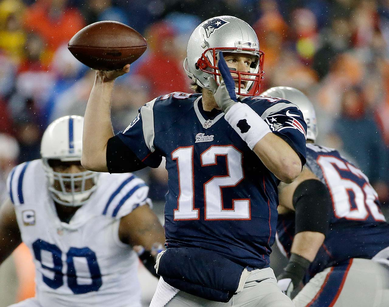 Tom Brady looks to pass during the first half.
