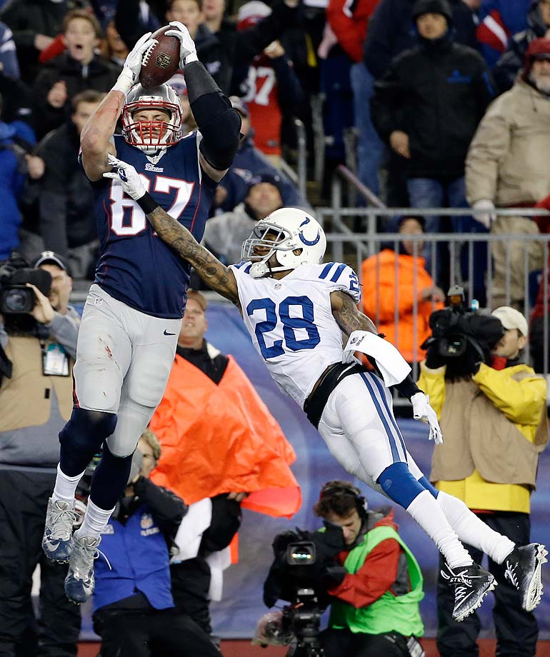 Rob Gronkowski cannot make a catch in the end zone over Colts cornerback Greg Toler during the first half.