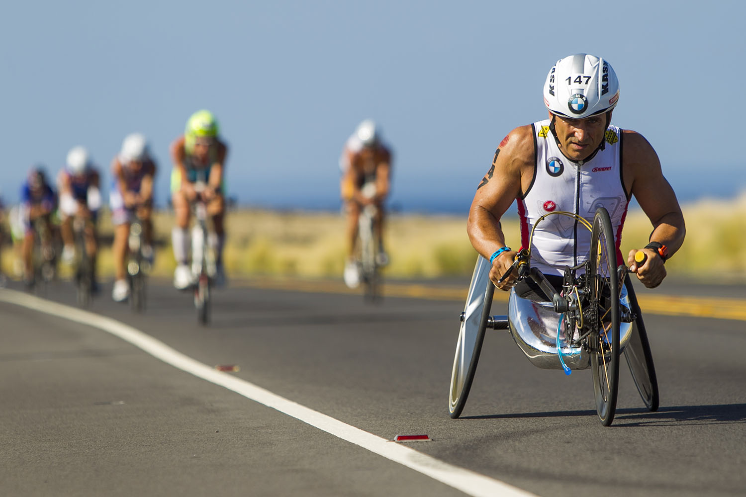 Paralympic handcycle champion Alex Zanardi leads a pack of racers during the 112-mile bike portion at the 2014 IRONMAN World Championship.