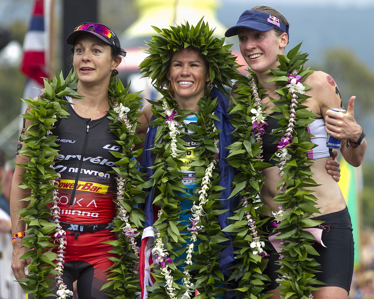 (Left to right) Rachel Joyce, Mirinda Carfrae and Daniela Ryf are seen at the finish line during the 2014 IRONMAN World Championship.
