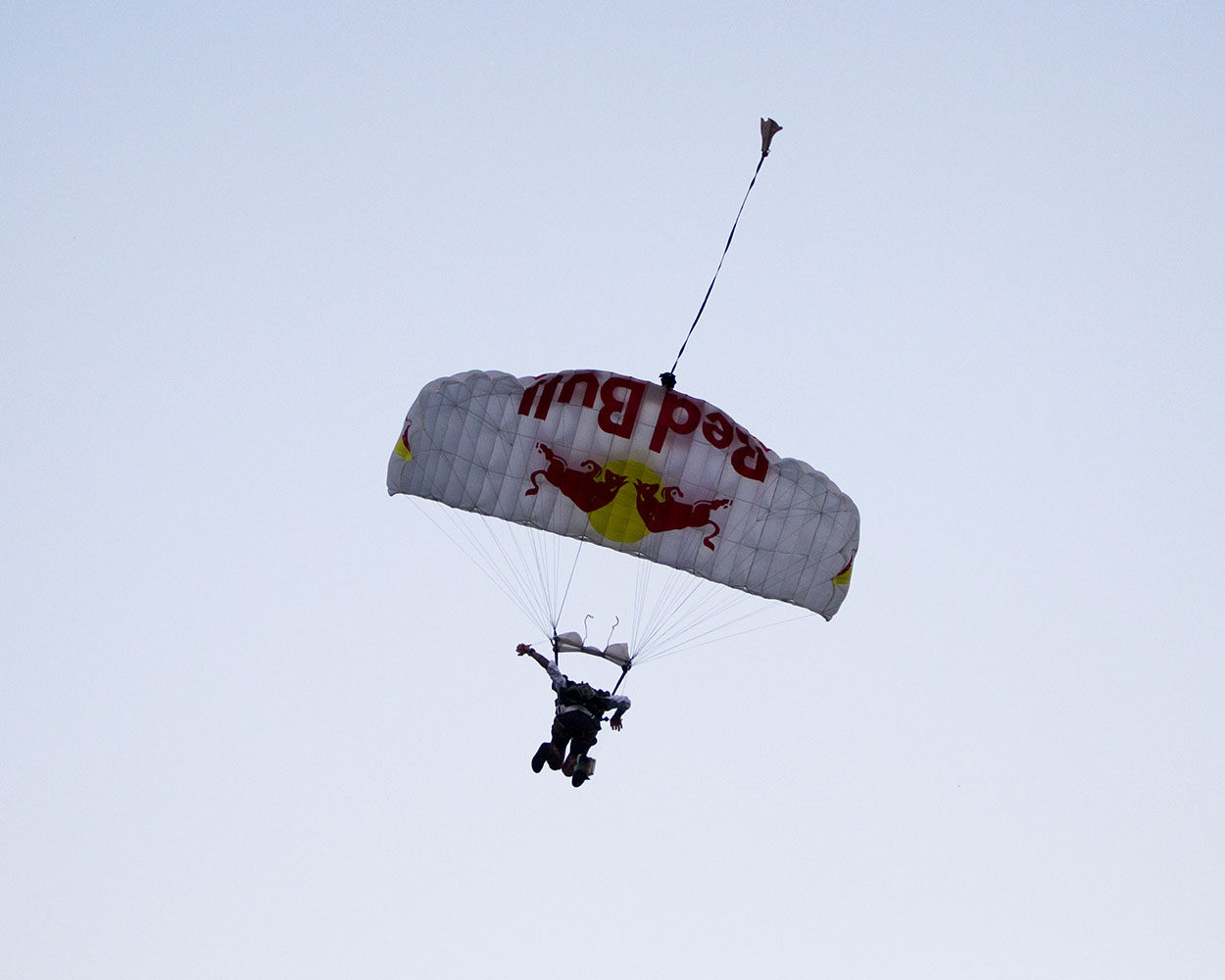 A Red Bull parachute team member jumps into the ocean before the start of the 2014 IRONMAN World Championship.