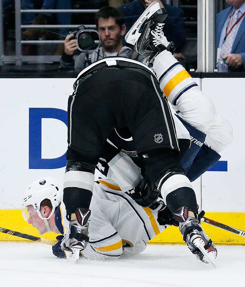 Buffalo Sabres center Jack Eichel gets contorted while being taken down by Dwight King of the L.A. Kings.
