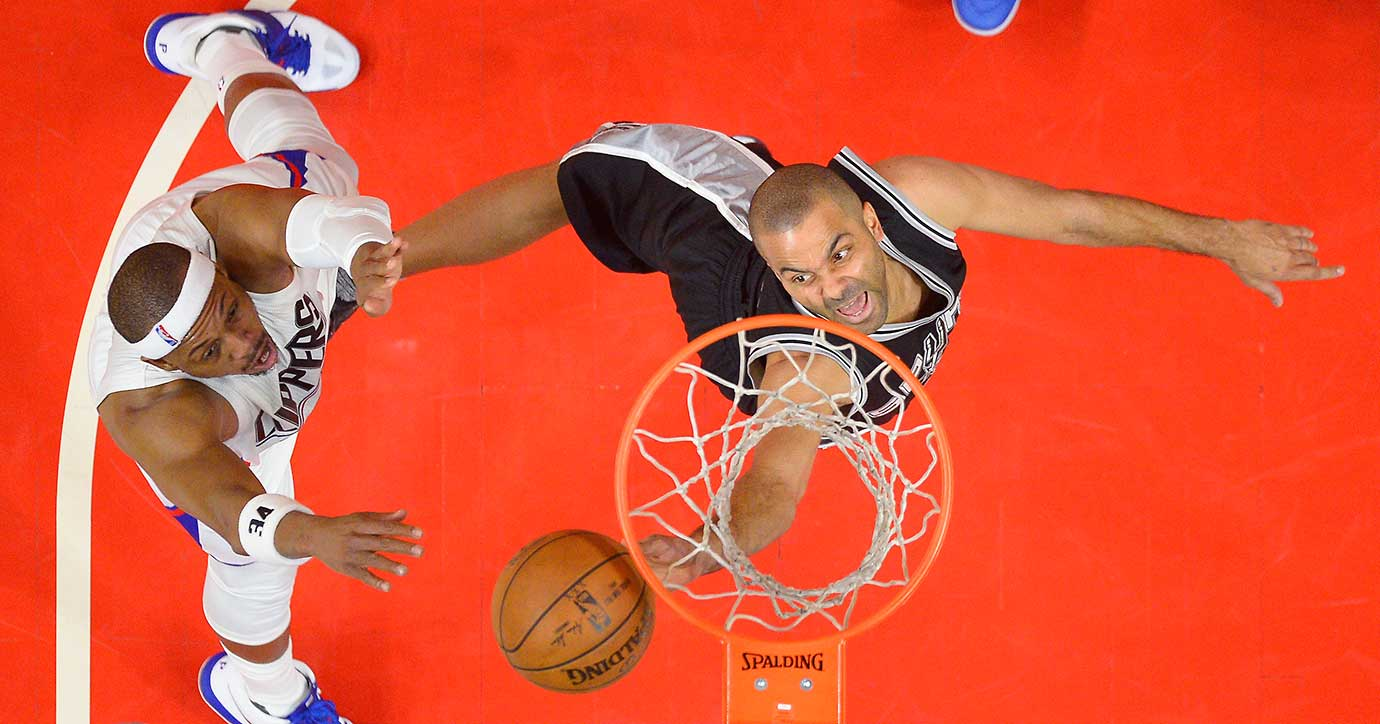 San Antonio Spurs guard Tony Parker shoots as Clippers forward Paul Pierce defends.