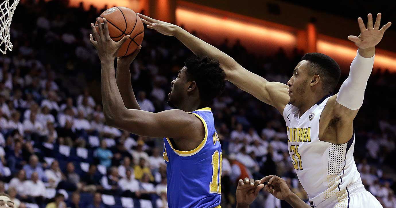 UCLA's Isaac Hamilton shoots past California's Stephen Domingo.