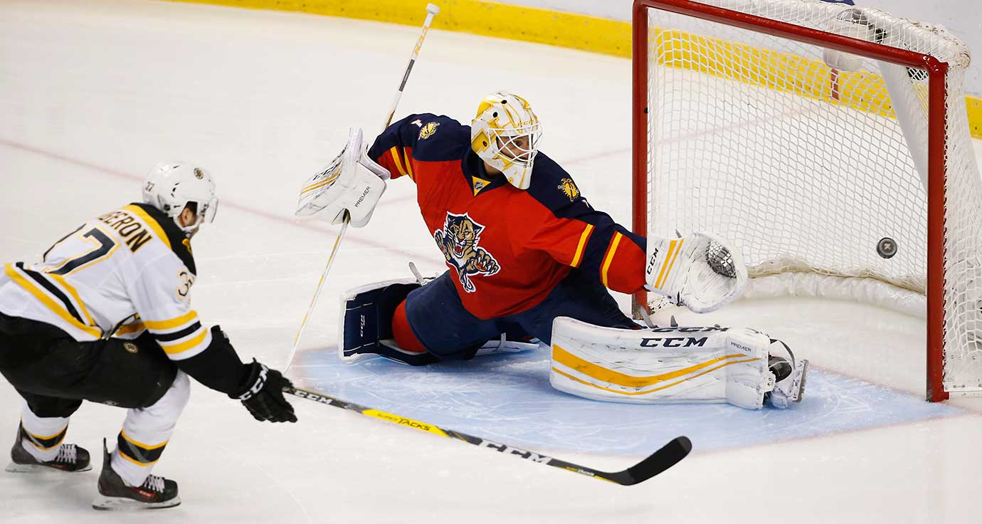 Boston Bruins center Patrice Bergeron scores against Florida goalie Roberto Luongo.
