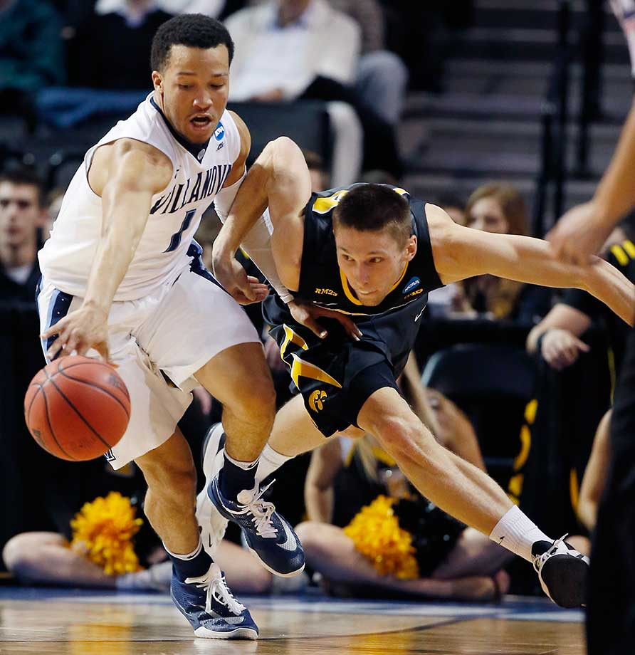 Villanova guard Jalen Brunson holds back Iowa forward Jarrod Uthoff during the Wildcats 87-68 rout.