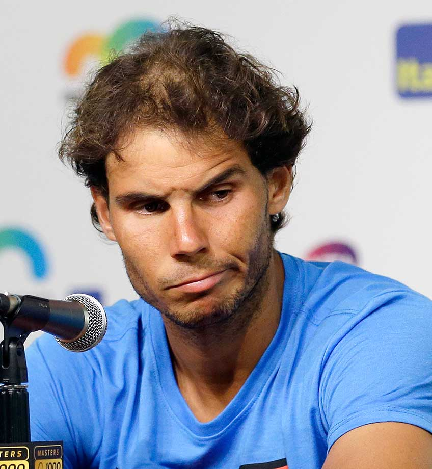 Rafael Nadal pauses during a news conference at the Miami Open. He faded in the subtropical heat and retired after falling behind in the third set of his match.