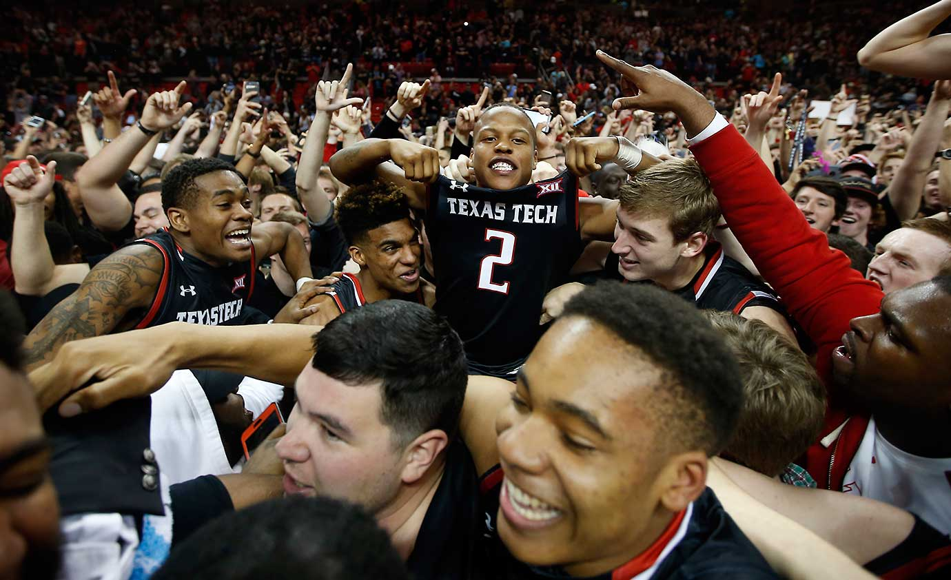 Texas Tech's Devon Thomas is hoisted in the crowd after Texas Tech defeated No. 3 Oklahoma 65-63 in Lubbock.