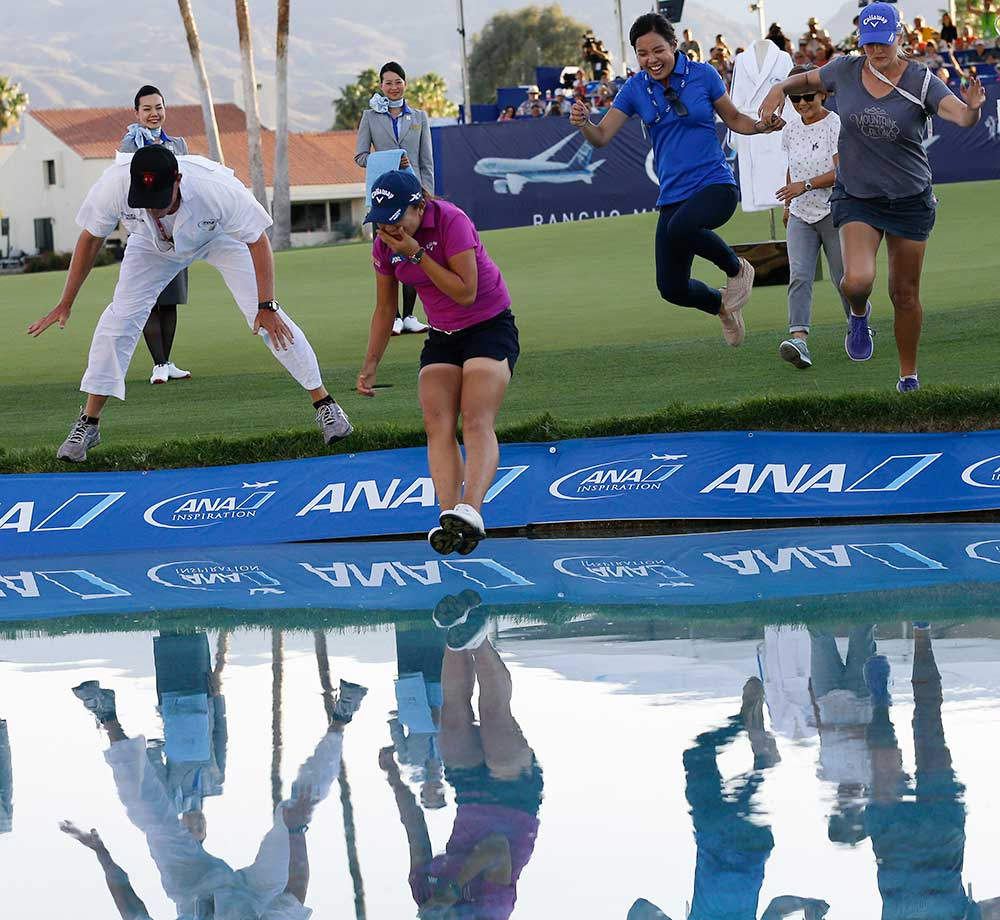 Lydia Ko of New Zealand jumps into Champions Lake after winning the LPGA Tour ANA Inspiration golf tournament in Rancho Mirage, Calif.