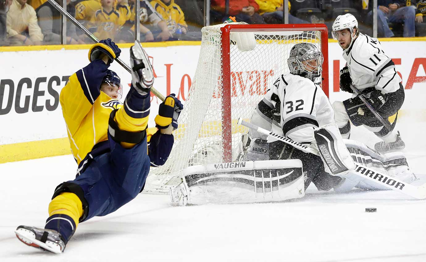 Los Angeles Kings goalie Jonathan Quick (32) blocks a shot by Nashville Predators forward Viktor Arvidsson.