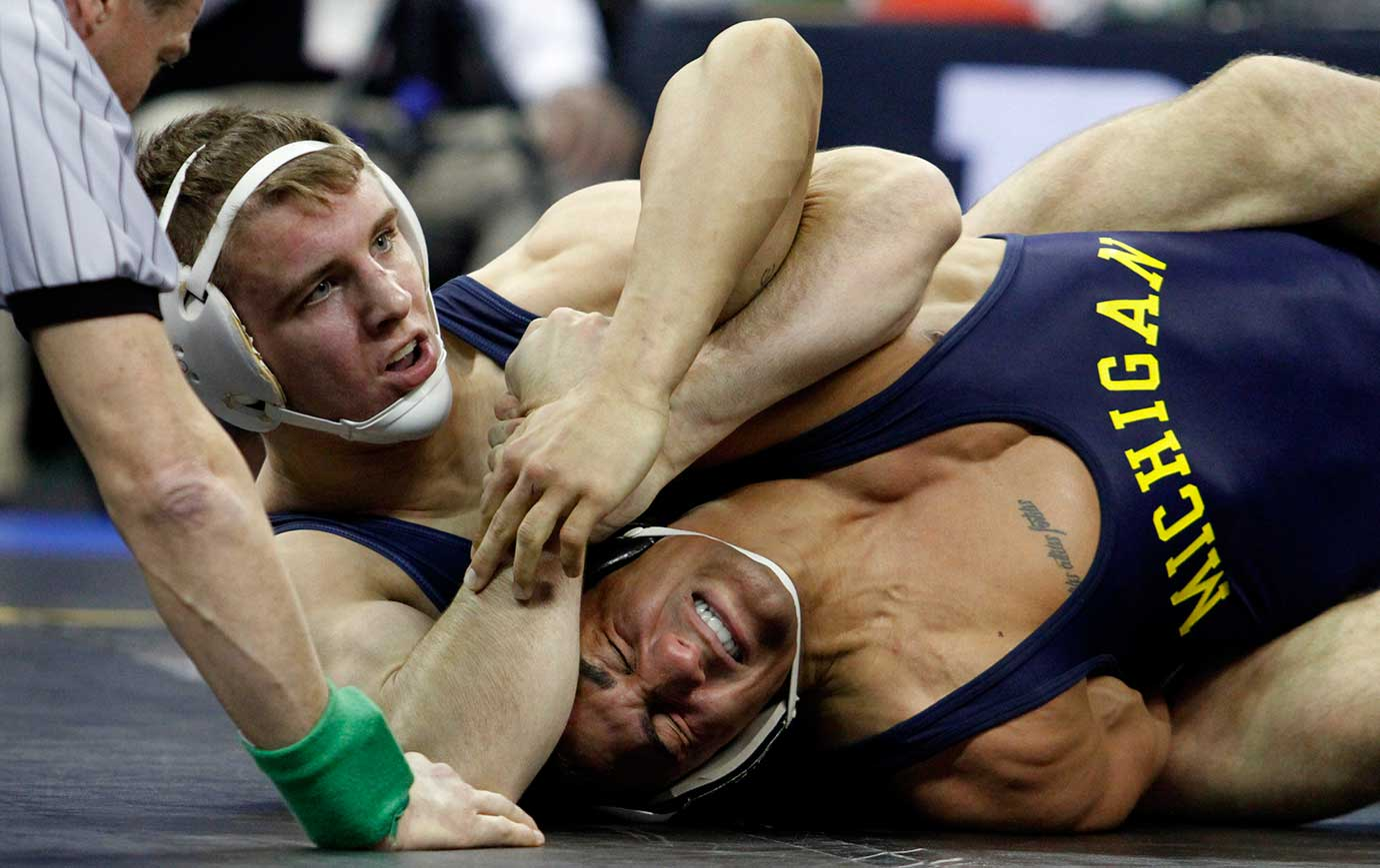 Penn State's Zain Retherford works to pin Michigan's Alec Panataleo in at the Big Ten wrestling championships.