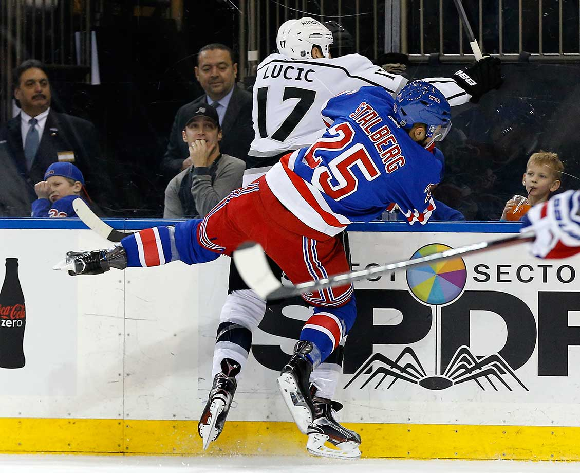 Viktor Stalberg of the New York Rangers collides with Milan Lucic of the Los Angeles Kings.
