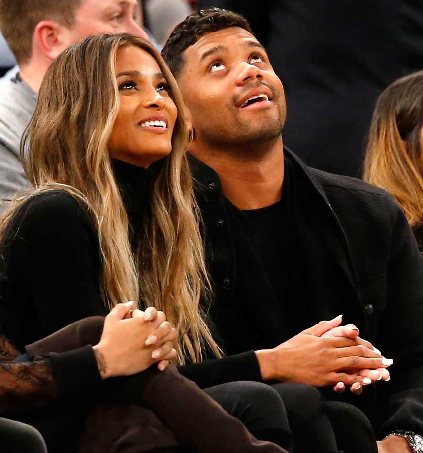 Singer Ciara and Seattle quarterback Russell Wilson sit courtside at the Knicks-Wizards game at Madison Square Garden.
