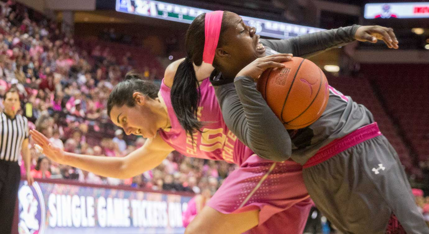 Florida State guard Leticia Romero, left, is called for a foul as Notre Dame guard Marina Mabrey comes down with a rebound.