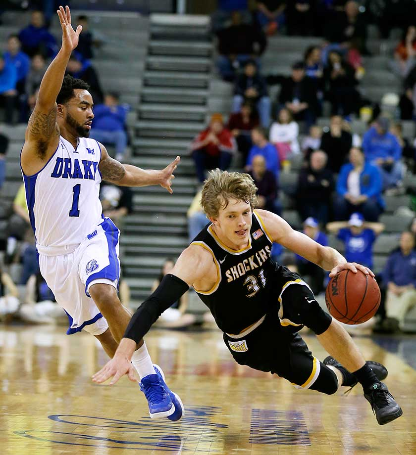 Wichita State guard Ron Baker is fouled by Drake guard Karl Madison in Des Moines, Iowa.