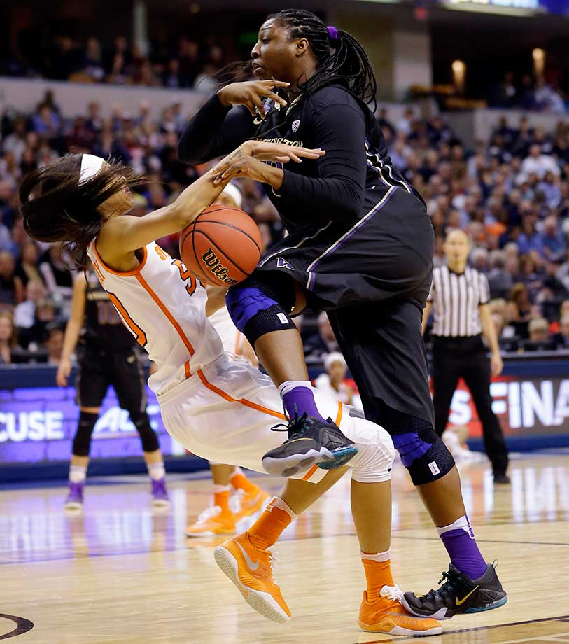 Washington's Chantel Osahor is called for a charging foul against Syracuse's Briana Day.