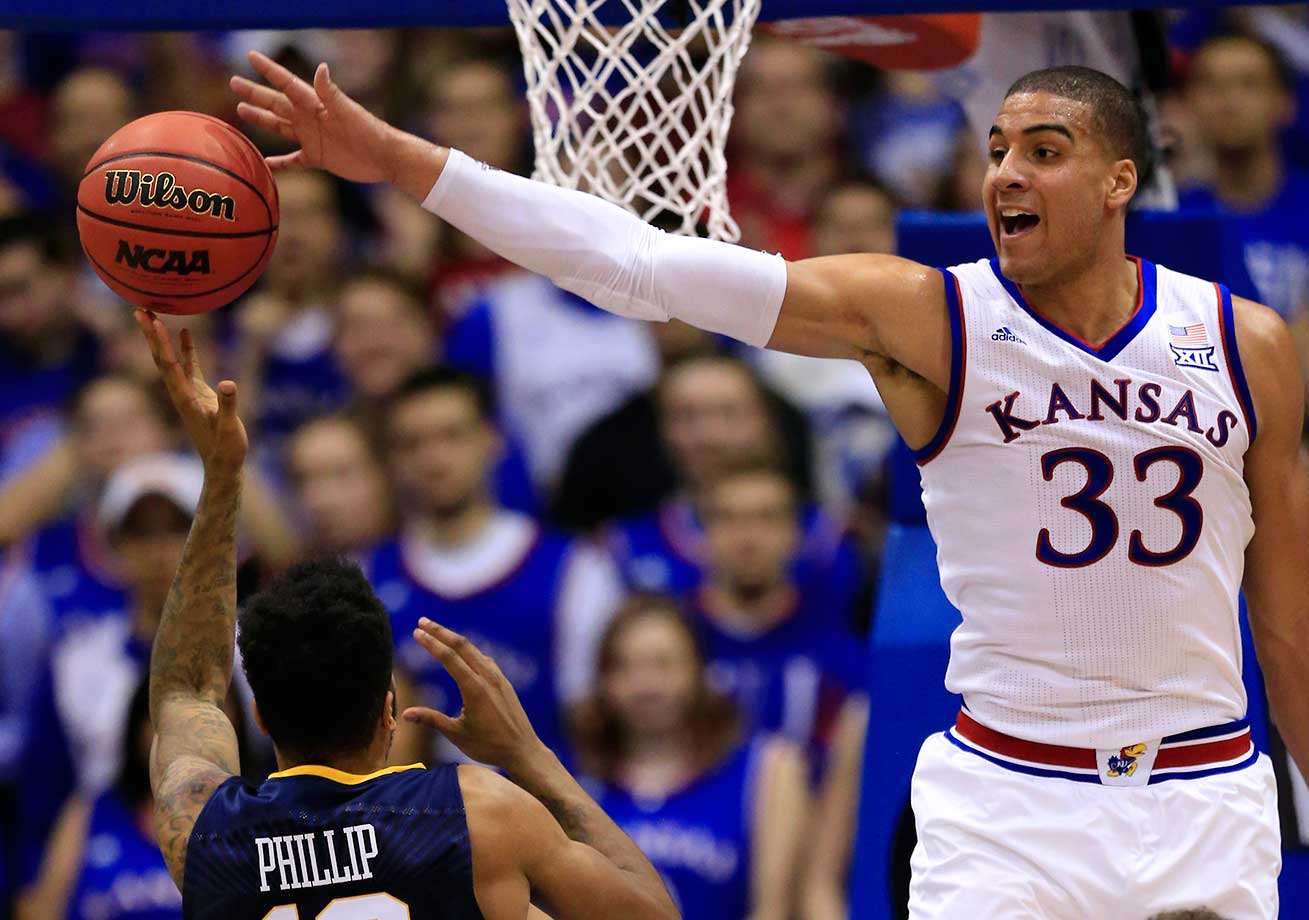 Kansas forward Landen Lucas blocks a shot by West Virginia guard Tarik Phillip.