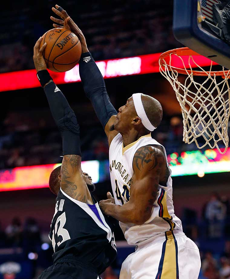New Orleans Pelicans forward Dante Cunningham blocks a shot by Sacramento Kings guard Ben McLemore.