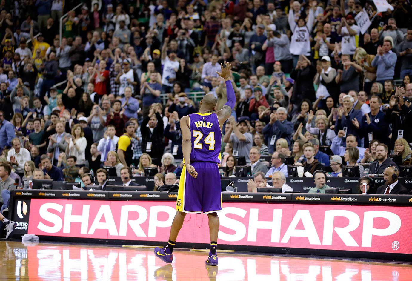 Kobe Bryant waves as he walks off the court in Utah for the final time in his career.