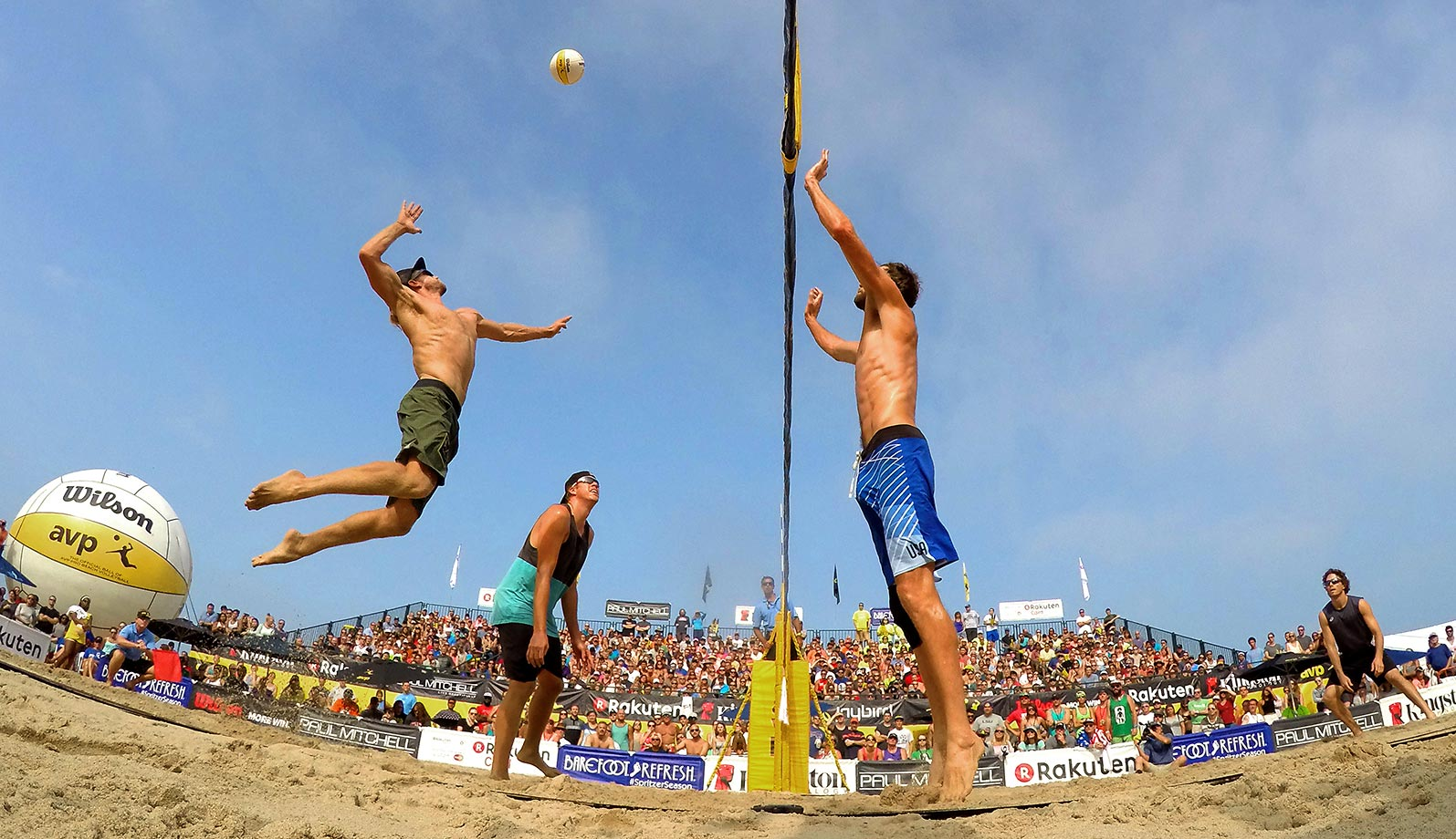 "An awesome shot of Ty Tramblie skying for a spike over 7'1"" Ryan Doherty."