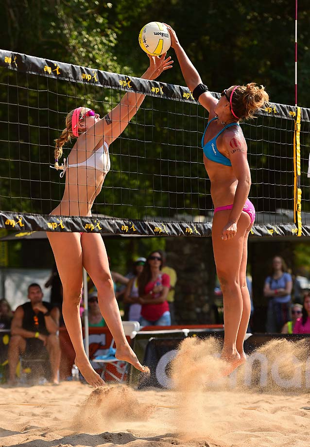 Summer Ross (L) and Whitney Pavlik duel at the net. The 3rd seeded team of Ross and Emily Day won the match in two --21-18 and 21-16.
