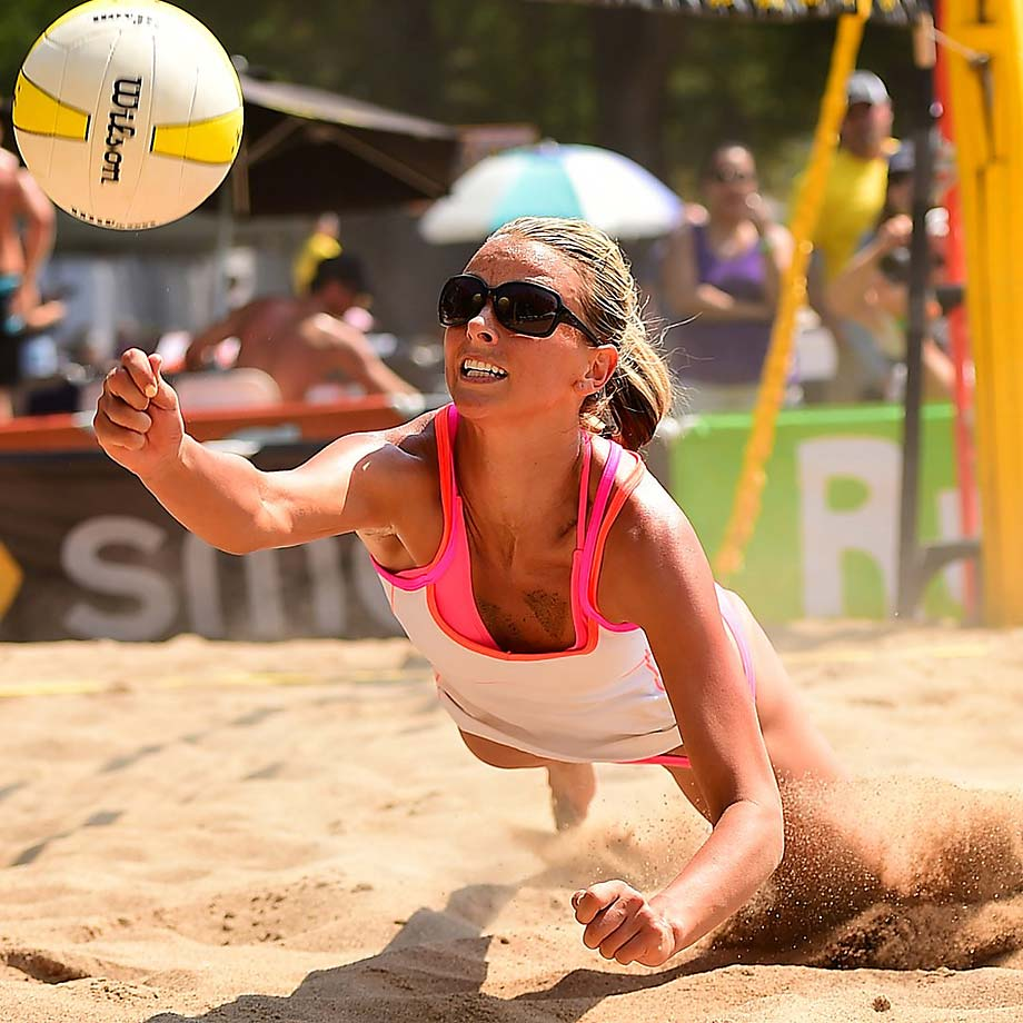 Jessica Gysin dives to save a ball for teammate Morgan Miller in a contenders bracket loss