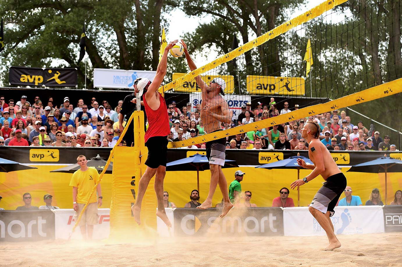 Big Brad Keenan pounds one past Casey Patterson. Keenan/John Mayer lost the quarterfinal match 21-18 and 28-26 to Patterson/Jake Gibb.                           Beach Volleyball: AVP Salt Lake City Open Tournament.