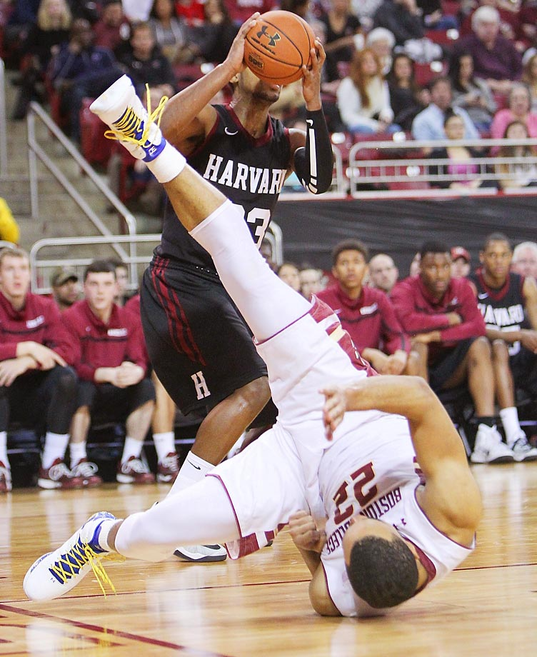Aaron Brown of Boston College flips as he falls in front of Wesley Saunders of Harvard.