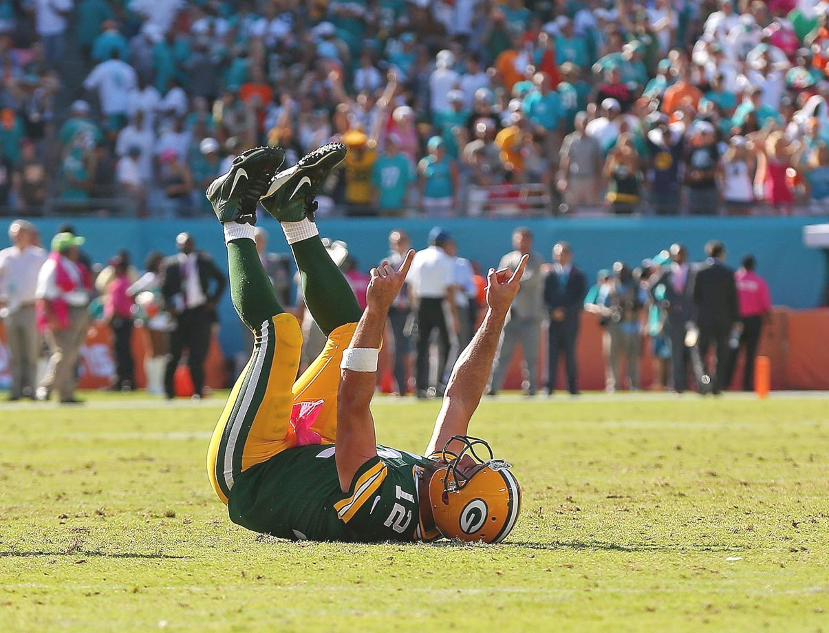 Aaron Rodgers celebrates the winning touchdown against the Miami Dolphins.