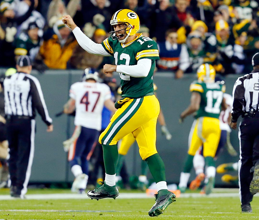 Green Bay Packers quarterback Aaron Rodgers celebrates a touchdown in the first half against the Chicago Bears Sunday. The Packers defeated the Bears 55-14 at home.