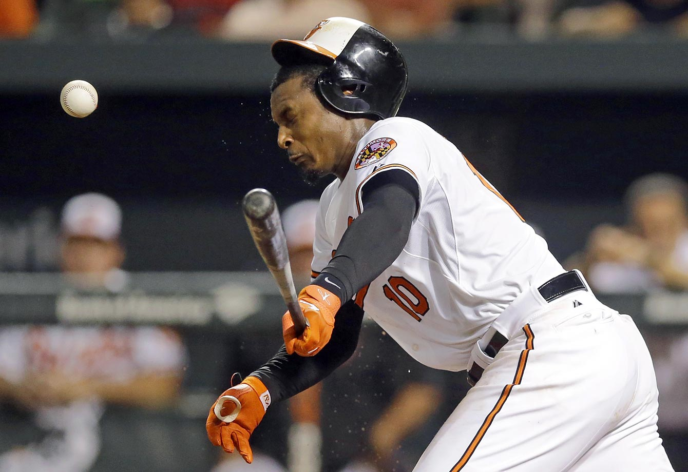 Adam Jones of the Baltimore Orioles fouls a ball off his head during a game against the Atlanta Braves.