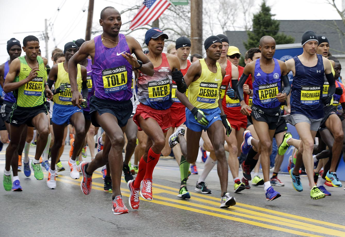 From left, Yemane Adhane Tsegay of Ethiopia, Wesley Korir of Kenya, Tadese Tola of Ethiopia, Meb Keflezighi of San Diego, Lelisa Desisa of Ethiopia, Lusapho April of South Africa, and Nicholas Arciniaga of Flagstaff, Ariz., leave the start line.